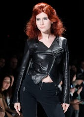 Anna Chapman, who was deported from the U.S. on charges of espionage, displays a creation by I Love Fashion during Mercedes-Benz Fashion Week in Moscow on March 22, 2012.