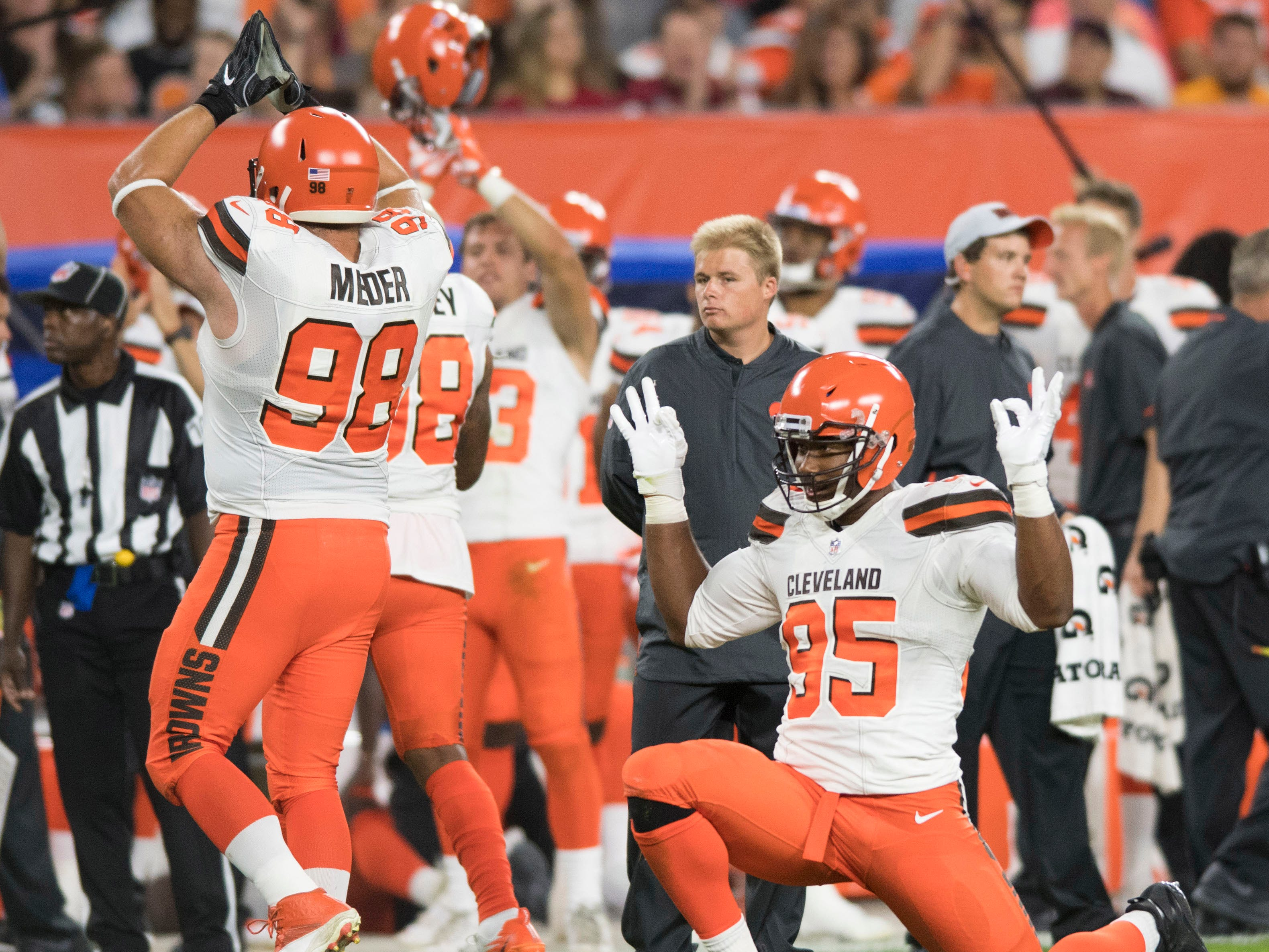 Cleveland Browns defensive tackle Jamie Meder (98) and defensive end Myles Garrett (95) celebrate after a replay showed that Garrett sacked Philadelphia Eagles quarterback Nick Foles for a safety during the first quarter at FirstEnergy Stadium.