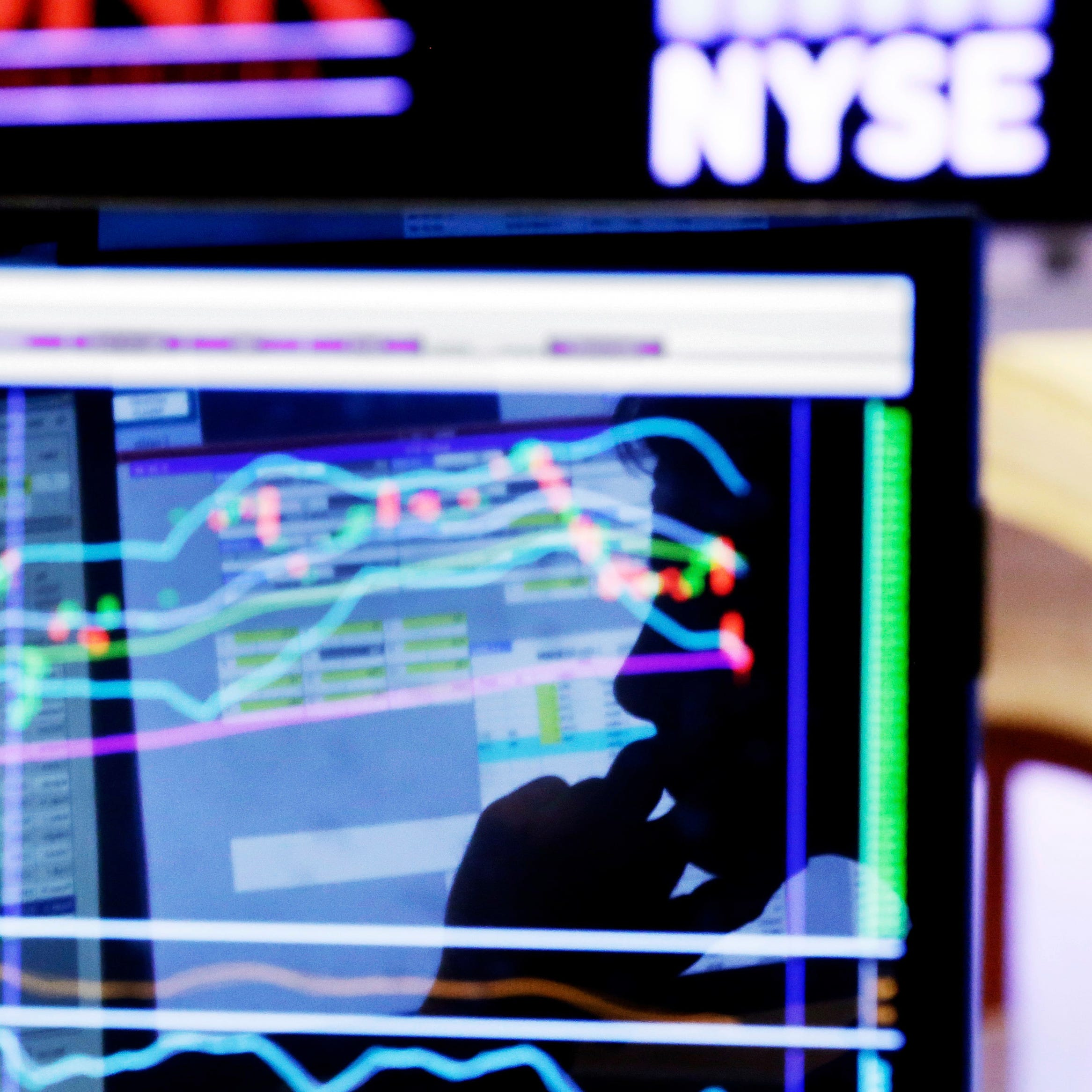 FILE - In this Jan. 11, 2016, file photo, specialist Anthony Rinaldi is silhouetted on a screen at his post on the floor of the New York Stock Exchange. The economy is growing, the stock market is soaring and unemployment remains low. It's the perfect time to prepare for the worst. (AP Photo/Richard Drew, File)