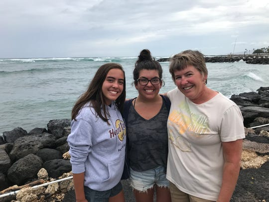 Kelly Scholten and her daughters at the beach near Waikiki in Honolulu the afternoon before Hurricane Lane was expected to hit. The family was visiting from Wisconsin and their flight out wasn't until Saturday, so they were making the best of the unusual turn of their vacation.