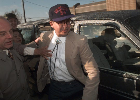 Former Marine Sgt. Clayton Lonetree, accompanied by his attorney Lee Calligaro at left, is hustled from a military prison van to Calligaro's car after making financial transactions at a bank in Leavenworth, Kan., on Feb. 27, 1996.