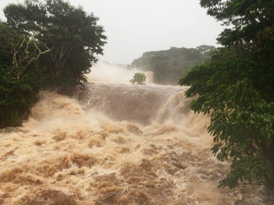 Hurricane Lane brought torrential rains to Hawaii's Big Island and Maui before the storm was expected to hit Oahu. A powerful hurricane unleashed torrents of rain and landslides Thursday that blocked roads on the rural Big Island.