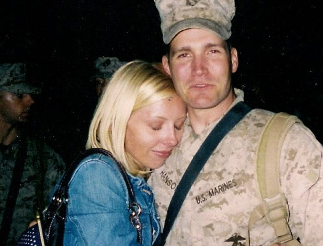 J.J. Hanson hugs his wife, Kristen, upon his return from a combat tour in Iraq.