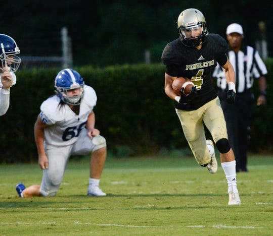 Pendleton junior Jason Wright-Mann runs during the first quarter at Pendleton High School in Pendleton on Friday, August 24, 2018.