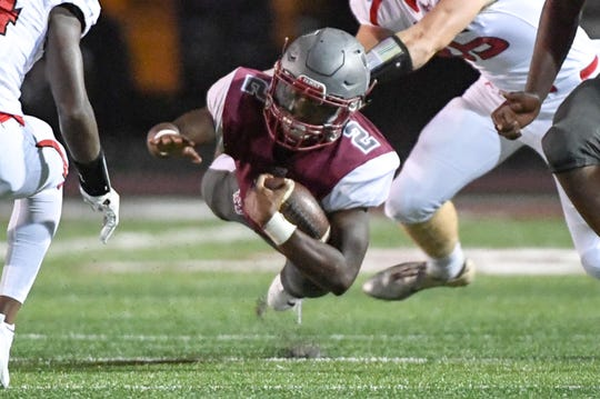 Westside quarterback Junior Smith dives for a first down during the fourth quarter at Westside High School in Anderson on Friday, August 24, 2018.