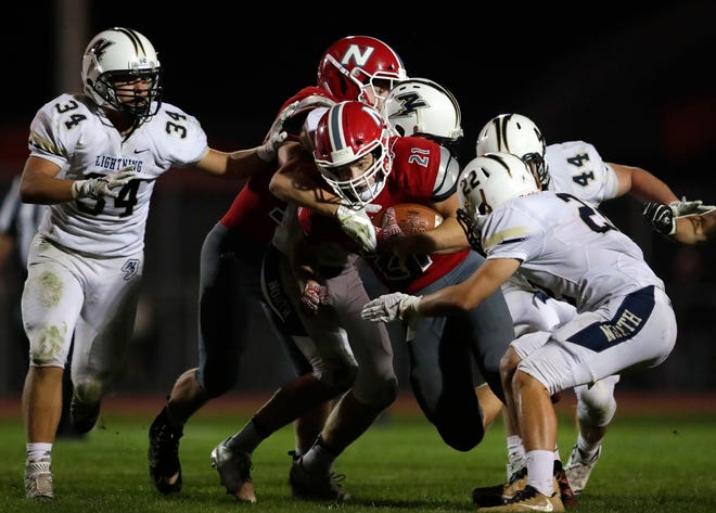 Neenah's Carson Hughes tries to make it through the Appleton North defense on Friday in Neenah. Danny Damiani/USA TODAY NETWORK-Wisconsin