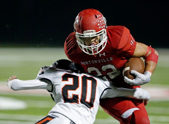 Jose Concepcion of Hortonville avoids a tackle by Tyler Paltzer of Kaukauna during a game in Hortonville.