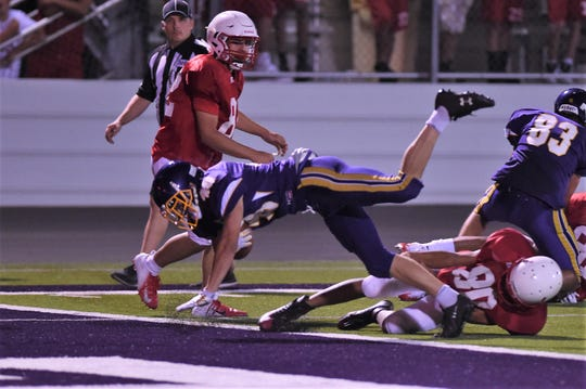 Wylie fullback Brazos Ham (40) dives into the end zone during the scrimmage against Odessa High at Bulldog Stadium.