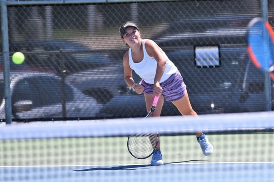 Wylie's Analeah Elias follows through on a serve during her girls doubles match against Hobbs (N.M.) in the AISD Tournament on Saturday, Aug. 25, 2018. The Bulldogs went 4-0 on the weekend.