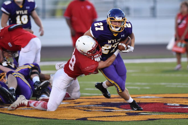 Wylie tailback Bailey Hicks (27) carries the ball during this year's scrimmage against Odessa High. The Bulldogs are searching for their first win of the season on Friday as they return home to host Wichita Falls Rider.