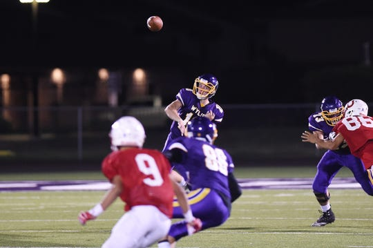 Wylie quarterback Harrison Atwood (19) throws a pass during the scrimmage against Odessa High at Bulldog Stadium,