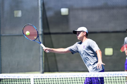 Wylie's Aric Richardson hits a shot at the net during his boys doubles match against Hobbs (N.M.) in the AISD Tournament on Saturday, Aug. 25, 2018. The Bulldogs went 4-0 on the weekend.