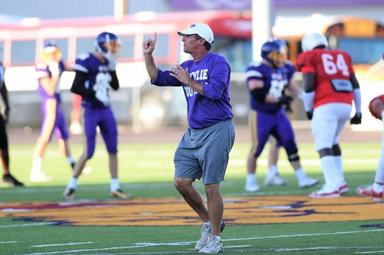 Wylie defensive coordinator Clay Martin gives instructions during the 2018 scrimmage against Odessa High. Martin was named the new head football coach and athletic director for the Bulldogs on Friday afternoon.