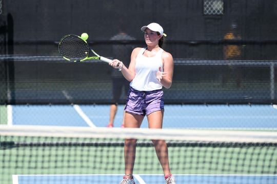 Wylie's Rebecca Yates hits a shot during her girls doubles match against Hobbs (N.M.) in the AISD Tournament on Saturday, Aug. 25, 2018. The Bulldogs went 4-0 on the weekend.