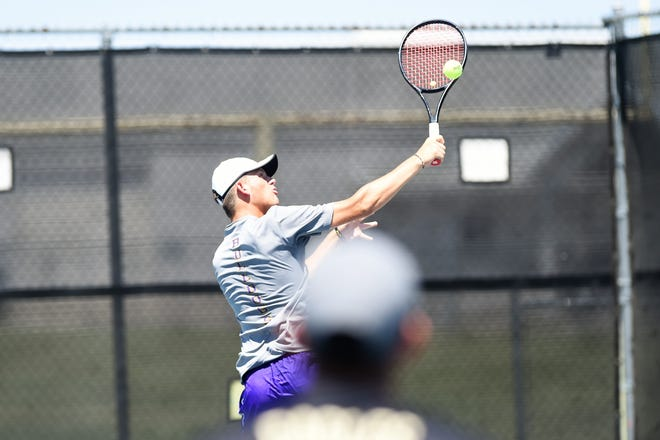 Wylie's Davyn Williford turns to hit a shot during his doubles match against Hobbs (N.M.) in the AISD Tournament on Saturday, Aug. 25, 2018. The Bulldogs went 4-0 on the weekend.