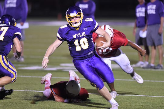Wylie quarterback Harrison Atwood (19) scrambles for yards during the scrimmage against Odessa High at Bulldog Stadium.
