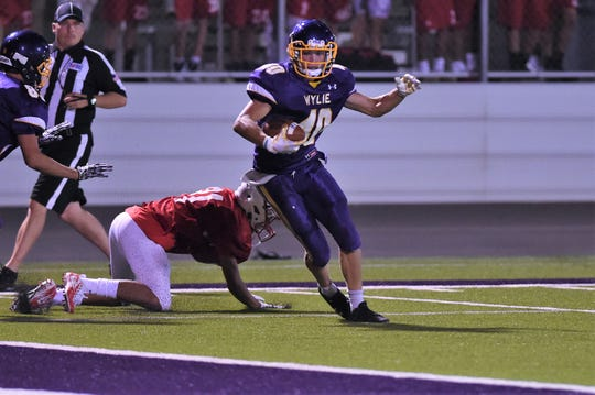 Wylie fullback Brazos Ham (40) spins after making a catch before reaching the end zone during the scrimmage against Odessa High.