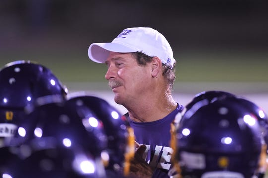 Wylie head coach Hugh Sandifer talks with his team after the scrimmage against Odessa High at Bulldog Stadium.