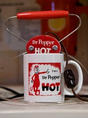 A warming device for making hot Dr Pepper is on display in Dublin. Dublin Bottling Works offers tours of its museum of vintage Dr Pepper items six days a week.
