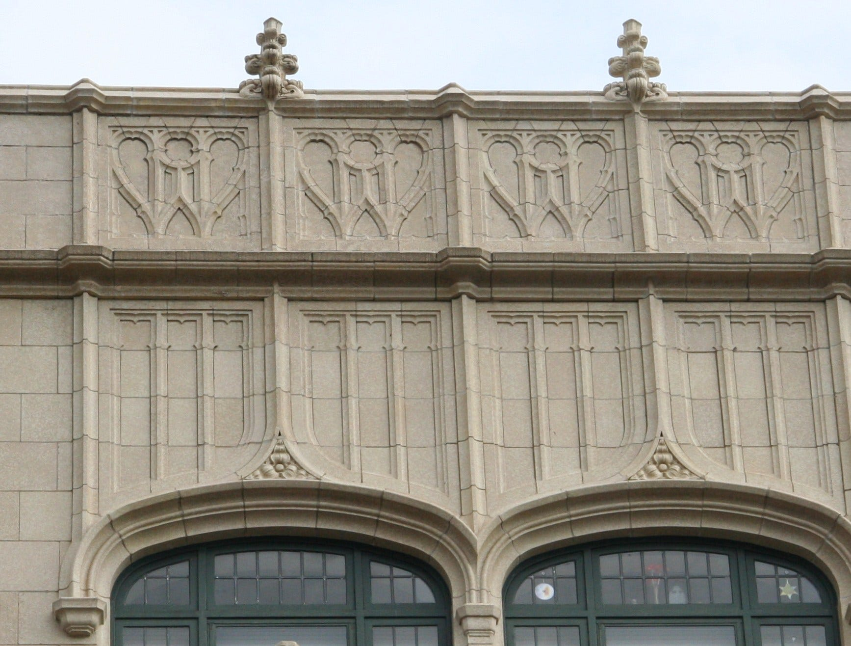 The name of the building's developer, E.W. Grove, is market at the top of the Grove Arcade.