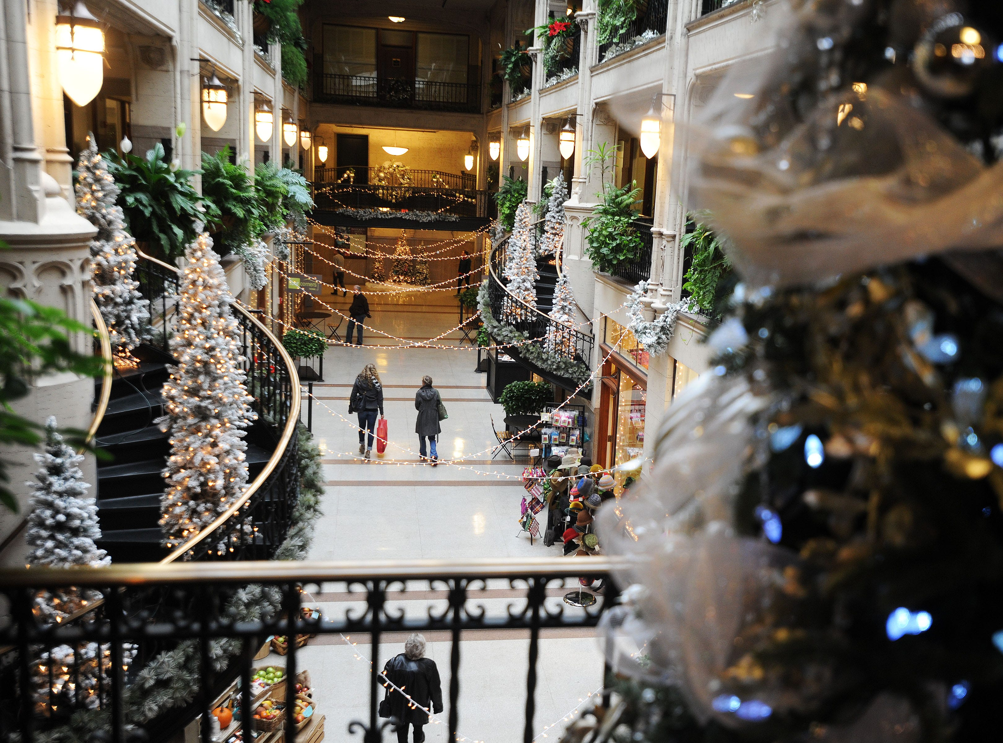 Shopper browse shops and eaters inside the Grove Arcade in downtown Asheville during lunchtime in December 2014.