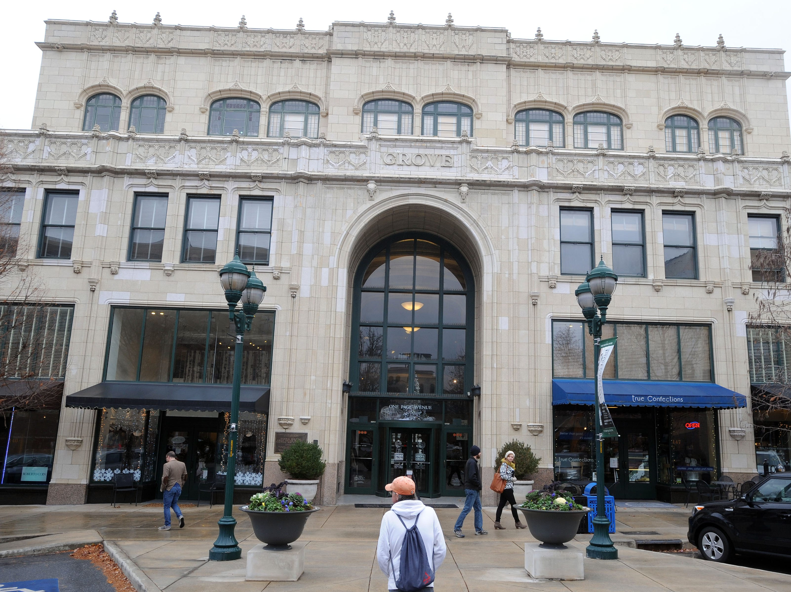 Residents walk in and around the Grove Arcade in downtown Asheville during lunchtime on Dec. 9, 2014.