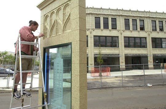 """in May 2002,  Jesse Fahrer of Fine Finishes put a terrra cotta finish on the """"Groves Vision"""" piece in front of the Grove Arcade. The piece was removed for construction of the Cambria Hotel but will return next year."""
