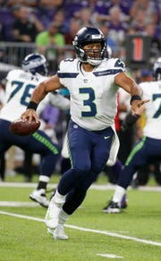 Seattle Seahawks quarterback Russell Wilson looks to throw a pass during the first half.