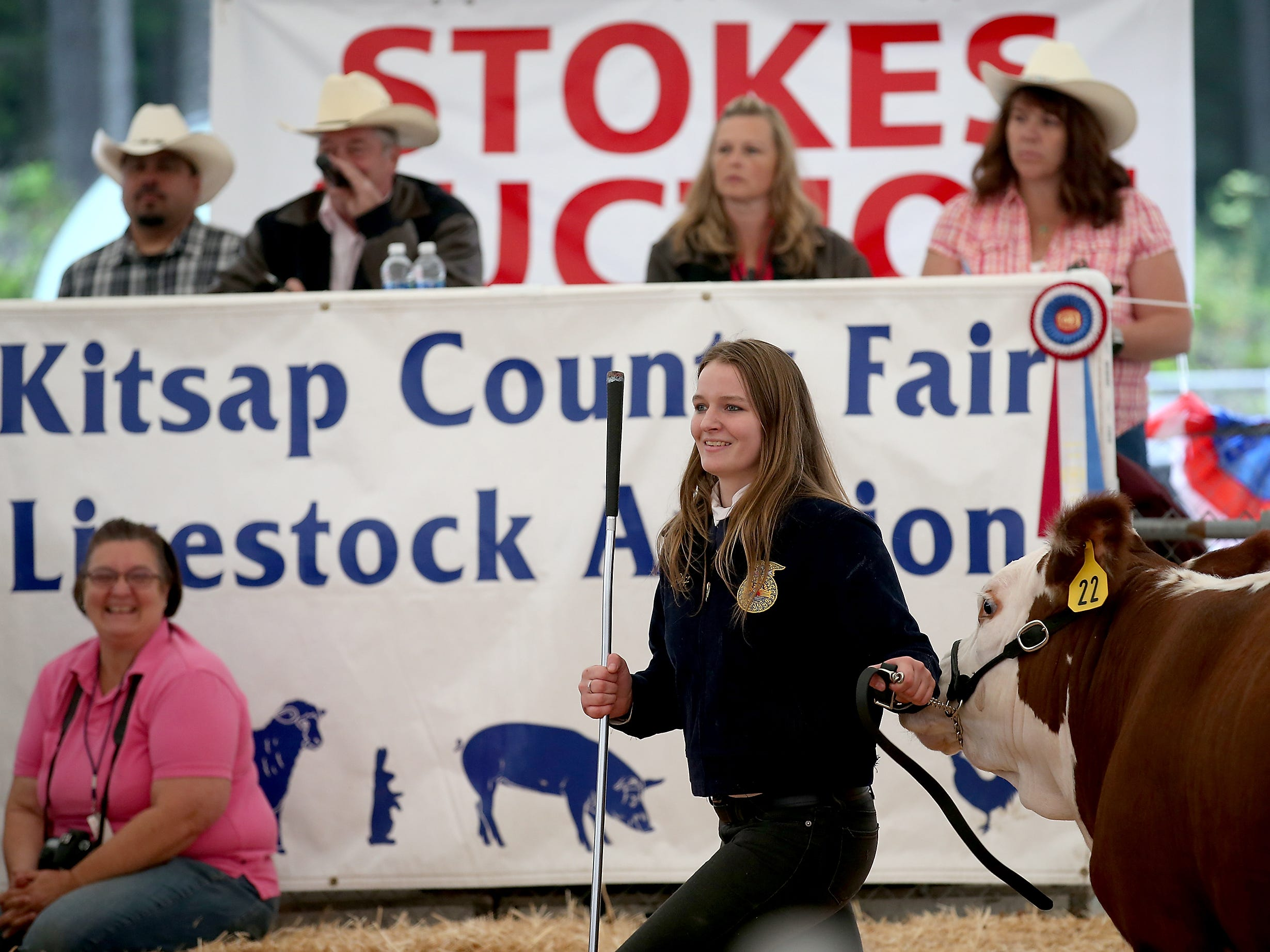 South Kitsap FFA member A.J. Shipp leads her steer around the auction ring at the Kitsap County Fair & Stampede on Saturday, August 25. 2018.