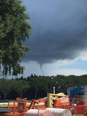 A funnel cloud was spotted over the Kennedy Space Center on Friday.