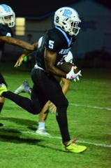 Jalen Mitchell carries the ball for the Raiders against Viera.