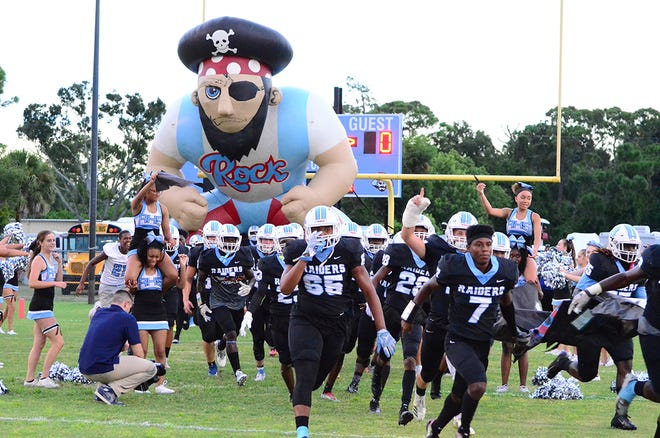 Rockledge players take the field for the 2018 season opener.