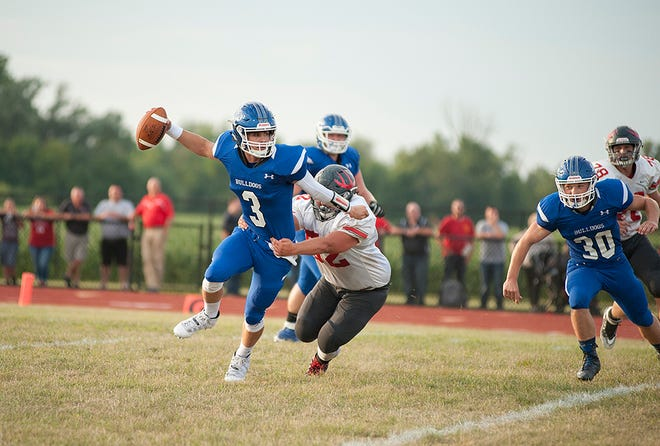 Crestline's Ty Clark attempts to shed a tackle from Buckeye Central's Grant Bishop.