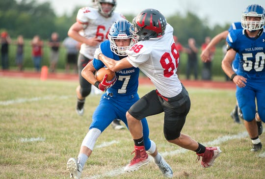 Buckeye's Davey Williams latches onto Crestline's Kaden Ronk.