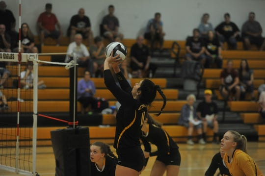 Colonel Crawford's Izzie Stalter pushes one over the net.
