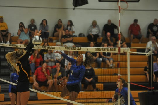 Ontario's Cammy Smith hits at the net against Colonel Crawford.