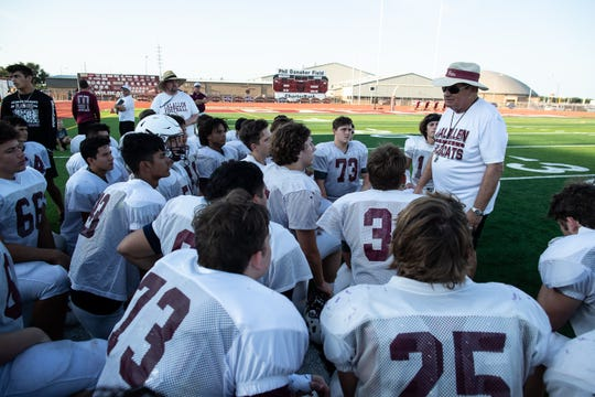 Calallen head coach Phil Danaher talks to his players before their scrimmage against Ray at Wildcat Stadium on Friday, Aug, 24, 2018.