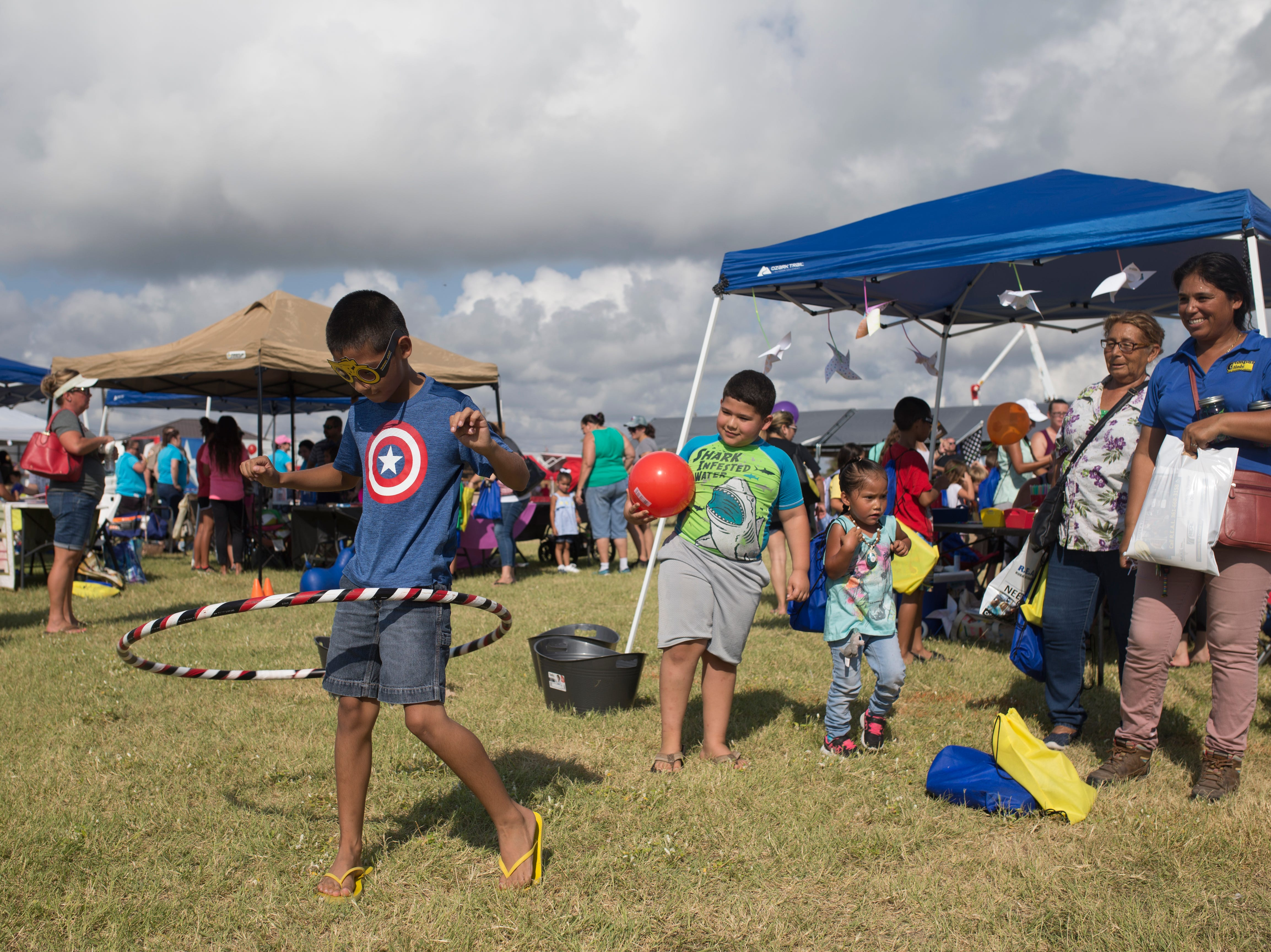 Justin Gonzalez, 10 (left), plays in the children's section during a remembrance ceremony to honor first responders for the anniversary of Hurricane Harvey on Saturday, Aug. 25, 2018 in Rockport.