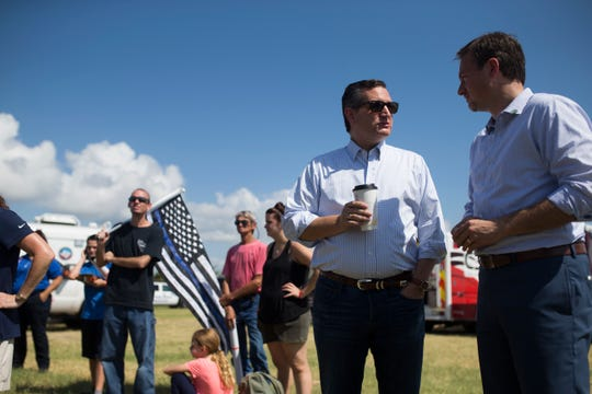 U.S. Sen. Ted Cruz speaks with U.S. Rep. Michael Cloud during a remembrance ceremony for the anniversary of Hurricane Harvey and to honor first responders on Saturday, Aug. 25, 2018 in Rockport.