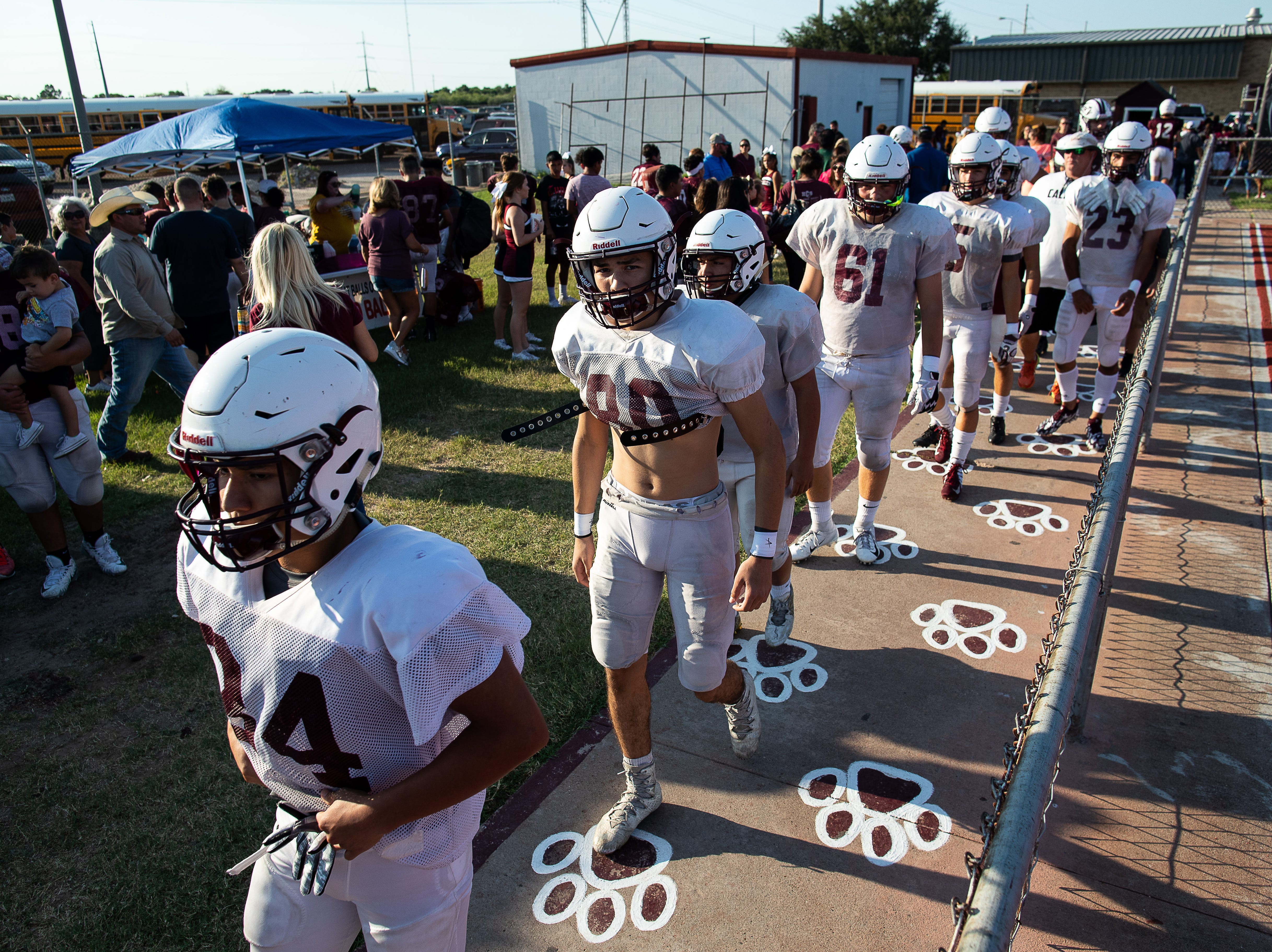 Calallen walks out on to the field before their scrimmage against Ray at Wildcat Stadium on Friday, Aug, 24, 2018.