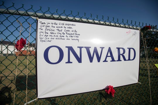 Signs line the Harvey Grateful Fence during a remembrance ceremony for the anniversary of Hurricane Harvey on Friday, Aug. 24, 2018, at the Texas Maritime Museum in Rockport.