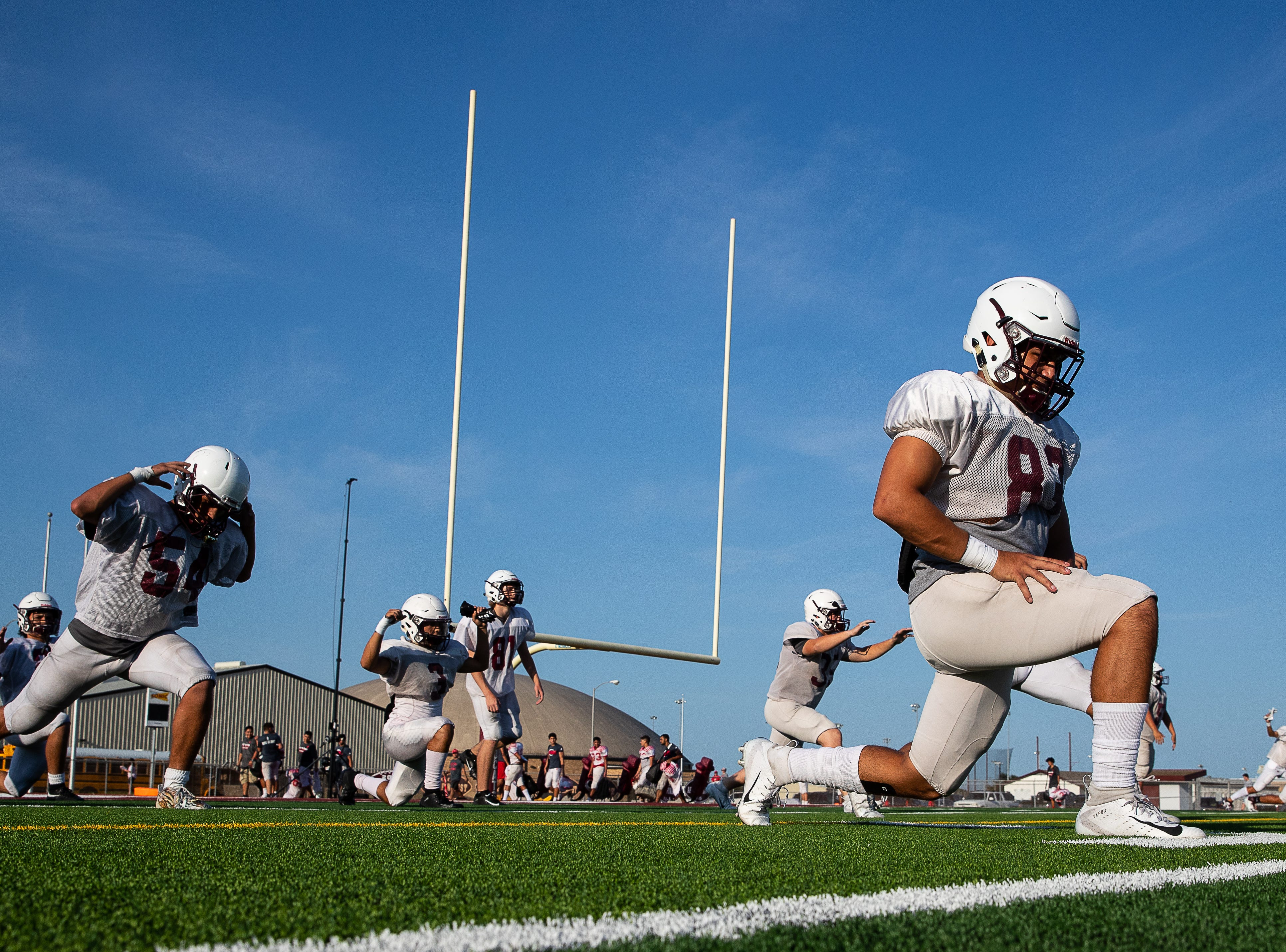 Calallen warms up on the field before their scrimmage against Ray at Wildcat Stadium on Friday, Aug, 24, 2018.