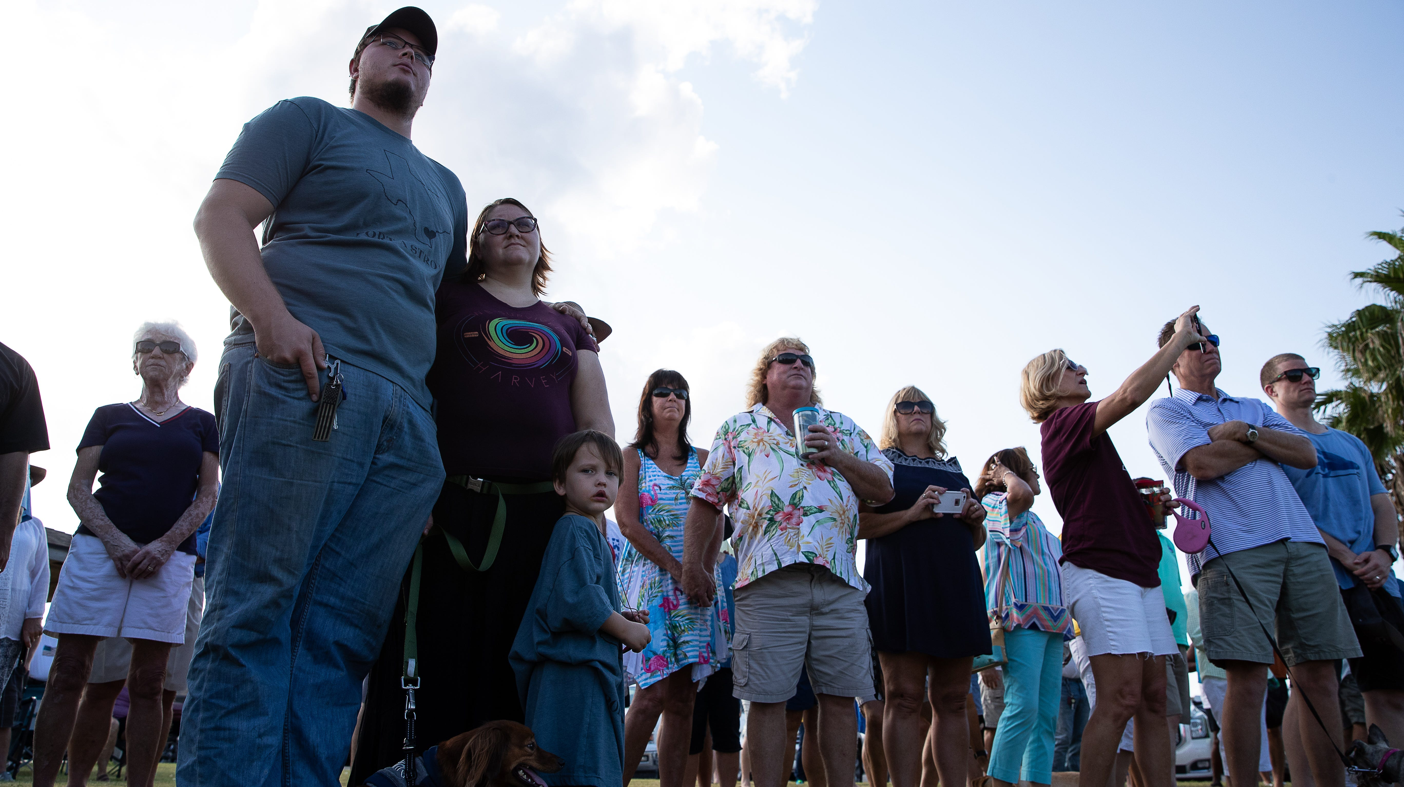 Residents of Port Aransas attend a ceremony in Roberts Point Park honoring first responders and the community on the first anniversary of Hurricane Harvey on Saturday Aug. 25, 2018.