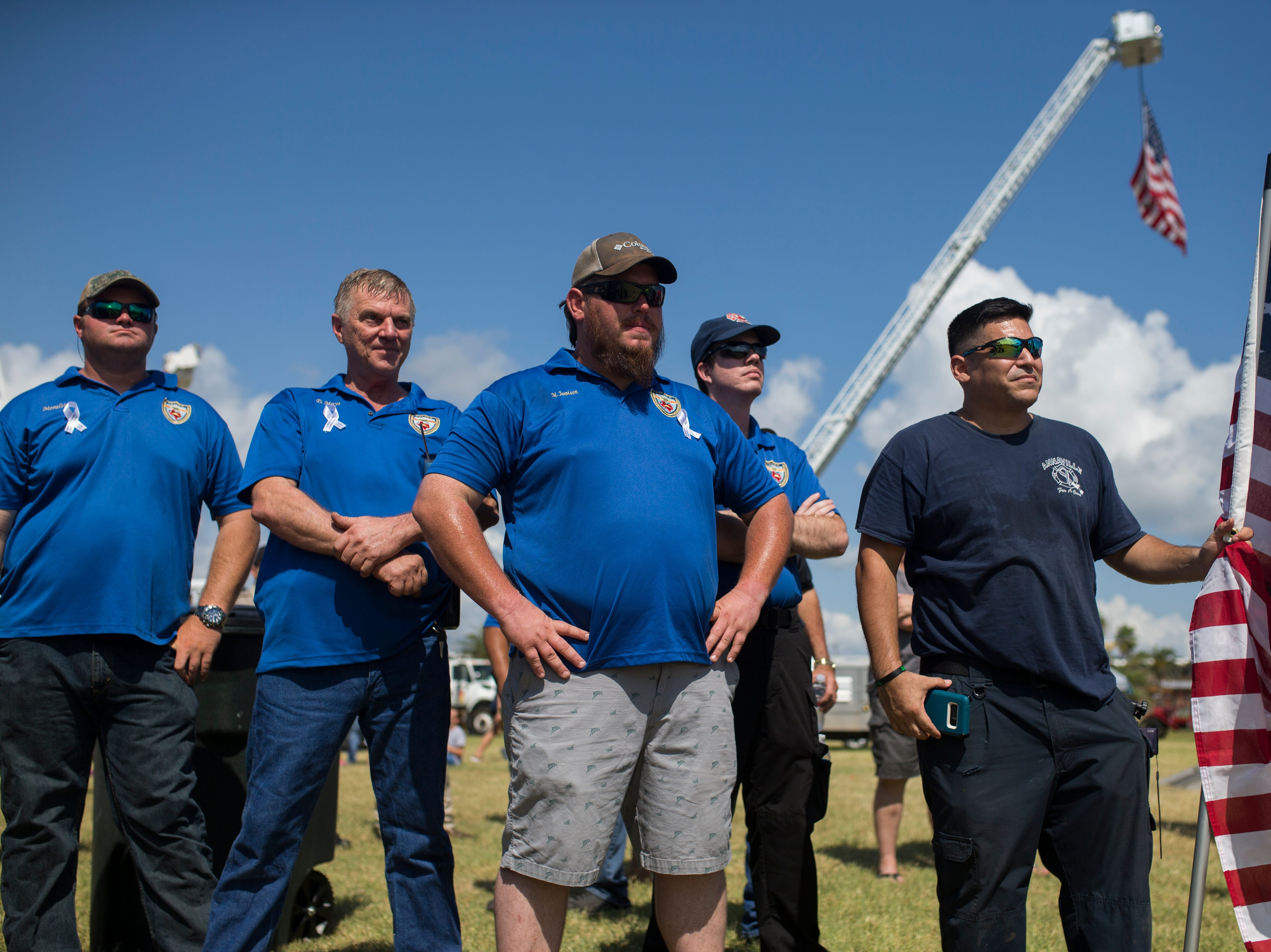 The Aransas County first responders listen to speakers during a remembrance ceremony and to honor first responders for the anniversary of Hurricane Harvey on Saturday, Aug. 25, 2018 in Rockport.