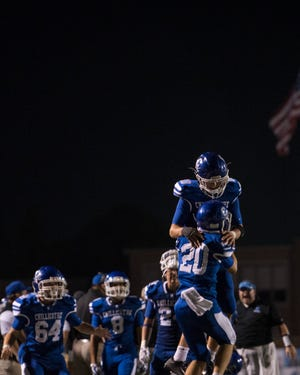 Chillicothe players rejoice as the Cavaliers defeat the Teays Valley Vikings 14-13 at Harris Family Complex on Friday, August 24, 2018.
