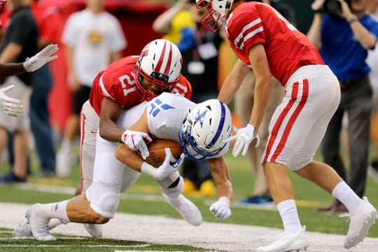 St. Xavier Bombers wide receiver Jared Kreimer (10) completes a catch along the sideline in the first quarter during a high school football game between the St. Xavier Bombers and the Lakota West Firebirds, Friday, Aug. 24, 2018, at Paul Brown Stadium in Cincinnati.