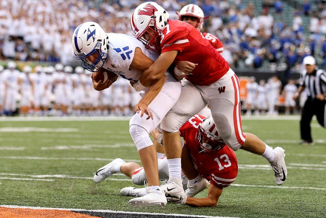 St. Xavier Bombers quarterback Wyatt Hudepohl (11) scores a touchdown in the first quarter during a high school football game between the St. Xavier Bombers and the Lakota West Firebirds, Friday, Aug. 24, 2018, at Paul Brown Stadium in Cincinnati.