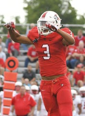 Colerain defensive back Deshawn Pace celebrates a Cardinal fumble recovery in the first quarter of the Skyline Chili Crosstown Showdown, Colerain Township, Friday August 24, 2018