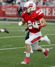 Beechwood running back Logan Castleman carries the ball against Lloyd during their game in Fort Mitchell Friday, August 24, 2018.