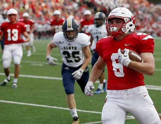Beechwood wide receiver John Odom scores a touchdown against Lloyd during their game in Fort Mitchell Friday, August 24, 2018.
